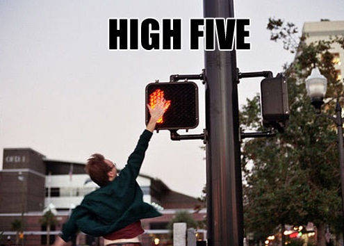 High five a street sign